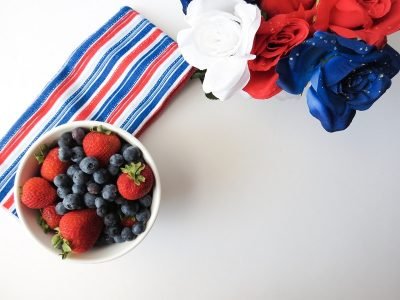 Patriotic Low Cal Cocktails Bowl of Strawberries and Blueberries Sitting on a Table