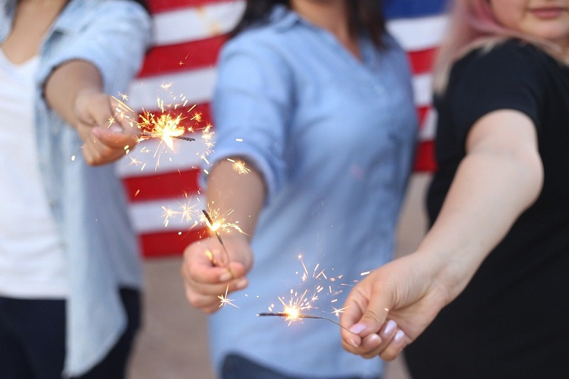 Patriotic Low Cal Cocktails Three People Holding Out Sparklers
