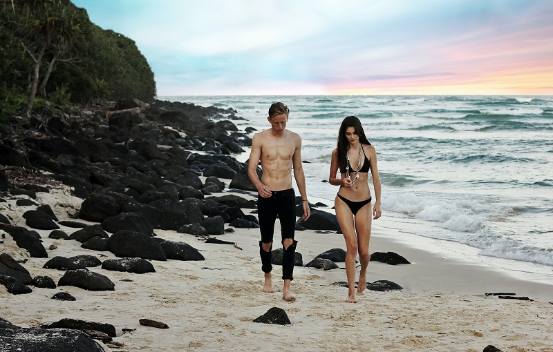 Ab Workouts Fit Couple Walking on Beach